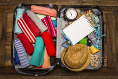 Travel preparations on wooden table Royalty Free Stock Photos