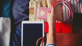Travel preparations on wooden table. 1920x1080 stock footage