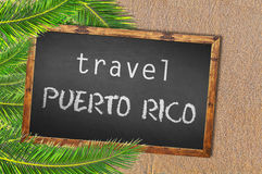 Travel Puerto Rico palm trees and blackboard on sandy beach. Close royalty free stock photos