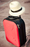 Travel red bag and straw hat Royalty Free Stock Photo