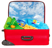 Travel red suitcase packed for summer vacation. Travel red suitcase. Packed for summer vacation in sea resort. Tropical beach. Isolated on white Royalty Free Stock Photos