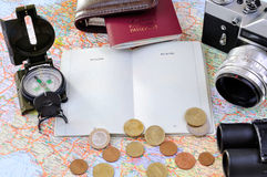 Travel related items on a map Stock Photography