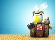 Travel. Retro suitcase with  hats on the sea Stock Images