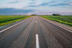 Travel Road Concept. Cloudy Sky. Nobody. Beautiful freeway empty asphalt road. Landscape with fields and sky. Nobody Stock Image
