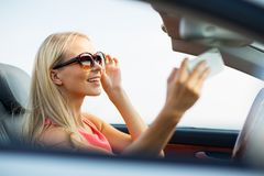 Woman in convertible car taking selfie Stock Photo