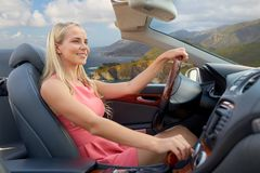 Woman driving convertible car on big sur coast Royalty Free Stock Image