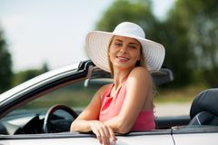 Happy young woman in convertible car Royalty Free Stock Images