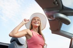 Happy young woman in convertible car Royalty Free Stock Photos