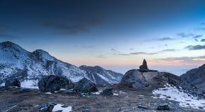 Romantic sunset in Himalaya mountain. Travel rujum stones in Himalaya trek of Gosaikunda lakes valley Royalty Free Stock Image