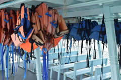 Travel and safety. Life jacket on the passenger boat to help the passenger can float on the water when boat had an accident or capsize stock photo