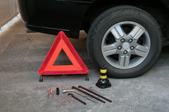 Travel safety preparation. Early warning device with tire changing tools royalty free stock photo