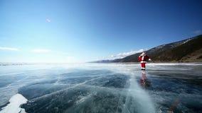 Travel Santa on Lake Baikal. Christmas holidays, Santa Claus walks around the lake Baikal, Siberia, Russia stock video