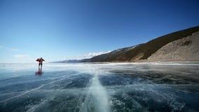 Travel Santa on Lake Baikal. Christmas holidays, Santa Claus walks around the lake Baikal, Siberia, Russia stock footage