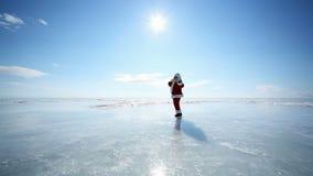 Travel Santa on Lake Baikal. Christmas holidays, Santa Claus walks around the lake Baikal, Siberia, Russia stock video footage