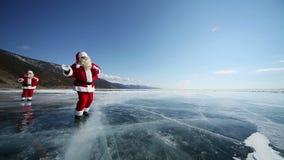 Travel Santa on Lake Baikal, Looping. Christmas holidays, Santa Claus walks around the lake Baikal, Siberia, infinity stock video footage