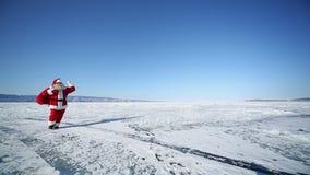 Travel Santa on Lake Baikal, Looping. Christmas holidays, Santa Claus walks around the lake Baikal, Siberia, infinity stock video