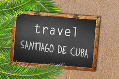 Travel Santiago De Cuba palm trees and blackboard on sandy beach Royalty Free Stock Photo