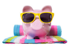 Travel savings, holiday money concept, Piggy Bank on beach vacation Royalty Free Stock Image