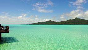 Lagoon at tropical beach in french polynesia. Travel, seascape and nature concept - lagoon at tropical beach in french polynesia stock video
