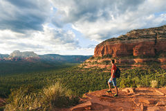 Travel in Sedona, man Hiker with backpack enjoying view, USA Stock Photo