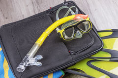 Travel set on suitcase with accessories for snorkeling Royalty Free Stock Images