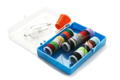 Travel Sewing Kit. Little blue plastic box with emergency sewing supplies - needles, pins, threads, thimble and buttons Stock Photo