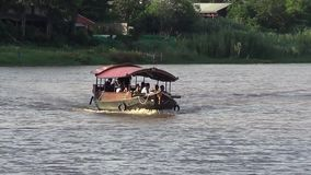 Travel Ship of  mae ping river cruise. CHIANGMAI, THAILAND - JUNE 11 2014 : Travel Ship of  mae ping river cruise. For travel in Ping river, Photo at Ping river stock video