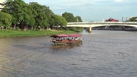 Travel Ship of  mae ping river cruise. CHIANGMAI, THAILAND - JUNE 11 2014 : Travel Ship of  mae ping river cruise. For travel in Ping river, Photo at Ping river stock footage