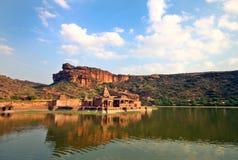 Travel shot of acient Badami temple in lake. Travel shot of Badami stone temple, a world heritage site Royalty Free Stock Photo