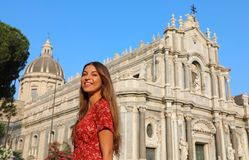Travel in Sicily. Beautiful smiling girl visiting Catania Cathedral at sunset. Summer holidays in Italy. Travel in Siciliy. Beautiful smiling girl visiting royalty free stock images