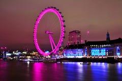 Iconic London Eye in night long exosure lights Stock Photos