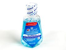 Travel Size Bottle of Crest Pro-Health Mouthwash on a White Backdrop. Crest Pro-Health Mouthwash on a white backdrop Royalty Free Stock Photography