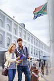 Travel south africa. South Africa tourism couple with guide book on vacation holiday Stock Photo