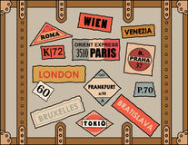 Travel Stickers. Vintage travel stickers on old luggage Royalty Free Stock Photos