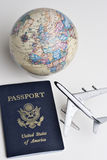 Travel still life. Still-life of an earth globe, passport and model airliner representing travel Stock Photo