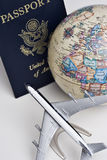 Travel still life. Still-life of an earth globe, passport and model airliner representing travel Royalty Free Stock Photo