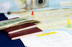 Travel still life. Still life with maps, passports, money and camera as metaphor for travel planning Royalty Free Stock Images