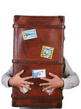 Travel suitcase. A man hugging travel suitcase Royalty Free Stock Photos