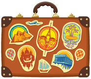 Travel suitcase. With stickers of different cities Stock Image