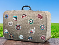 Travel suitcase on background with grass Stock Image
