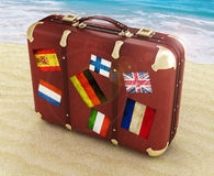 Travel suitcase. On the beach Stock Photos