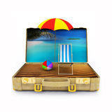 Travel Suitcase with Beach Chairs and Umbrella Stock Photo