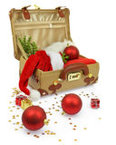 Travel suitcase with Christmas ornaments. Isolated on white Royalty Free Stock Photos