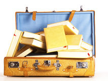 A travel suitcase full of books Royalty Free Stock Image