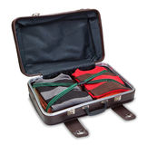 Travel suitcase full of clothes. Stock Images