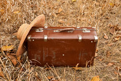 Travel suitcase and hat. Travel brown suitcase and hat Royalty Free Stock Images