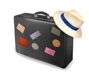 Travel suitcase and a hat. Vector Stock Images