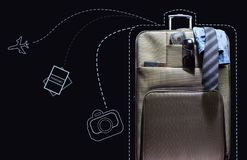 Travel suitcase with line-art signs. stock photography
