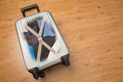 Travel Suitcase Packed with Clothes Stock Photo