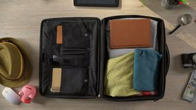 Travel suitcase packed quickly, preparations for vacation trip, time lapse. Stock footage stock video footage